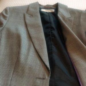 A ladies three piece pant suit.